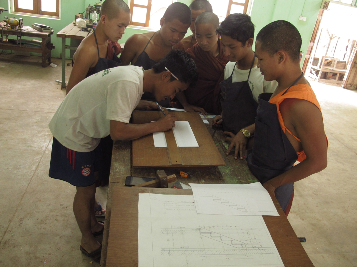 Htoo Twin planning a stair for the Hostel with his carptenter-troop