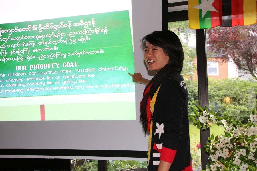 Myo explaining PDO Mandalay to her friends in Germany